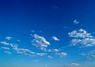 Sparse clouds in blue sky