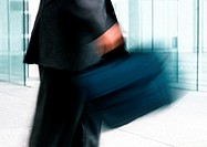 Man holding bag, mid section, blurred motion