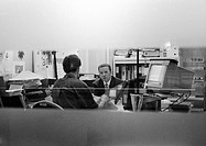 Two men in office, b&w