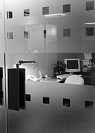 Desk behind glass doors, b&w