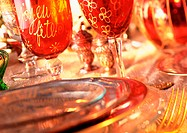 Plates, blurred, and wine glasses, close-up