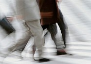 Business people walking on pedestrian crossings, low section, blurred, b&w