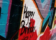 Graffiti with 'Happy Birthday' on wall