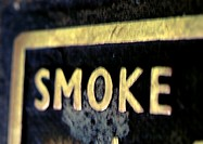 'Smoke' text on sign, close-up