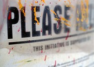 'Please' text printed in block capitals and paint spatterings