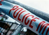 'Police' text on police line, close-up