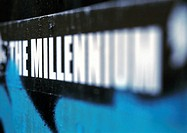 'The millenium' text printed in capital letters, blurred