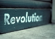 'Revolution' text, blurred