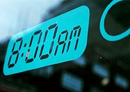 '8:00AM' text on alarm clock screen, close-up
