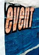 'Event' text printed on torn poster, close-up