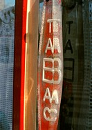'Tobacco' text in French on sign, blurred
