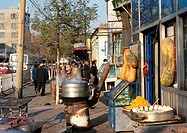 China, Xinjiang, Urumqi, food being sold on sidewalk