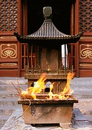 China, Beijing, fire burning in altar at temple entrance