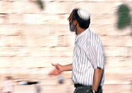 Israel, Jerusalem, mature man wearing kippa near Wailing Wall, blurred