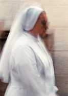 Nun, side view, blurred