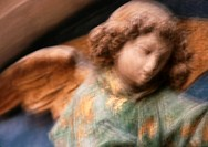 Statue of angel, close-up, blurred