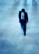 Businessman walking, high angle view, blurred
