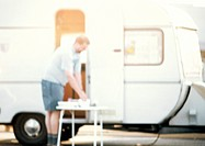 Man standing in front of camper, blurred