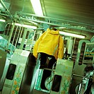 Young man jumping over turnstile in subway