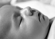 Sleeping baby´s face, side view, close-up, B&W