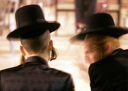 Israel, Jerusalem, two Orthodox Jews conversing, blurred motion