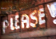 'Please' painterly typography on brick wall, montage