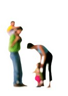 Silhouette of parents with two children, on white background, defocused