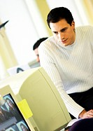 Man looking at computer monitor in office