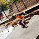 Young man in mid-air on skateboard
