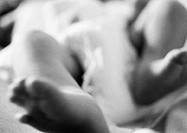 Baby's legs, close-up, b&amp;w