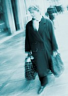 Woman carrying shopping bags, blurred