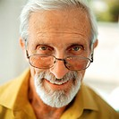Senior man smiling, close-up, portrait