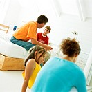 Parents and children sitting in bedroom
