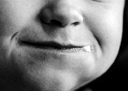 Child's face, close-up on mouth, b&w