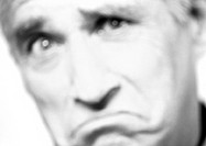 Mature man frowning, close-up, portrait, blurred, b&amp;w