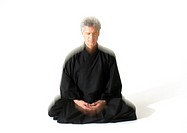 Man sitting indian style, meditating