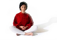 Woman sitting indian style, meditating