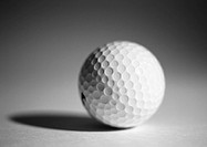 Golf ball, close-up, b&w