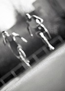Male athletes running fast, blurred motion, b&w (thumbnail)
