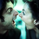 Man and woman face to face, both screaming, close-up
