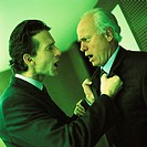 Two businessmen arguing, side view