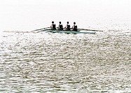 Four men rowing crew in boat, b&amp;w