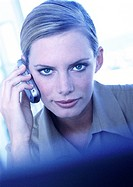 Businesswoman using cell phone, portrait (thumbnail)