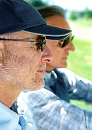 Two mature men wearing sunglasses, close-up, side view