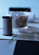 Thread and sewing needles, close-up