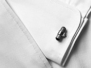 Cufflink, close-up, b&amp;w