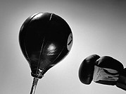 Boxing glove and punch ball, close-up, b&amp;w