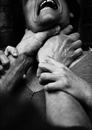 Hands strangling woman, close-up, b&amp;w