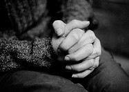 Clasped hands, close-up, b&amp;w