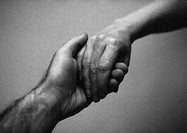 People holding hands, close-up, b&w